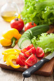 Fresh vegetables cucumber tomatoes pepper and salad leaves Stock Images