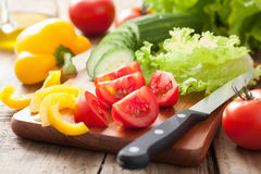 Fresh vegetables cucumber tomatoes pepper and salad leaves stock image