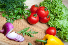 Fresh vegetables on cutting board. Stock Image