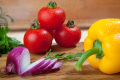 Fresh vegetables on cutting board. Royalty Free Stock Photos