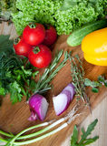 Fresh vegetables on cutting board. Royalty Free Stock Image