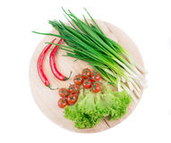 Fresh vegetables on cutting board Royalty Free Stock Images