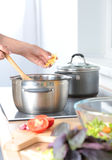 Fresh vegetables on the cutting board are falling in the pot, concept of cooking Stock Photos