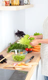 Fresh vegetables on the cutting board are falling in the pot, concept of cooking Stock Photo