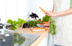 Fresh vegetables on the cutting board are falling in the pot, concept of cooking Royalty Free Stock Photo