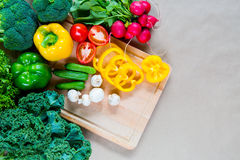 Fresh vegetables on a cutting board. Healthy Ingredients for vegetarian dinner Royalty Free Stock Images