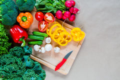 Fresh vegetables on a cutting board. Healthy Ingredients for vegetarian dish Royalty Free Stock Photo