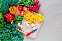 Fresh vegetables on a cutting board. Healthy Ingredients for vegetarian dish. Top view Stock Image
