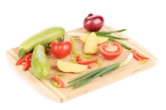 Fresh vegetables on cutting board. Stock Images