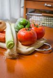 Fresh vegetables on cutting board in the kitchen stock photography