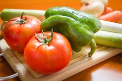 Fresh vegetables on cutting board in the kitchen Stock Images