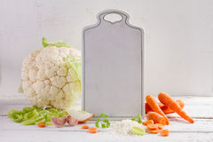 Fresh vegetables with cutting board Stock Photography