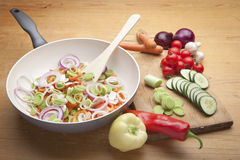 Fresh vegetables on the cutting board and in pan Royalty Free Stock Photography