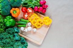 Fresh vegetables on a cutting board. Fresh raw vegetables on a cutting board. Healthy Ingredients for vegetarian dinner Royalty Free Stock Image