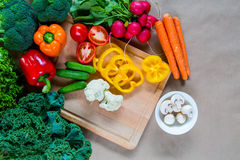 Fresh vegetables on a cutting board. Raw vegetables on a cutting board. Healthy Ingredients for vegetarian dish. Top view Royalty Free Stock Image
