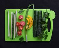 Fresh vegetables on the cutting Board stock photos