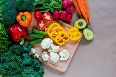Fresh vegetables on a cutting board. Top view of Raw organic vegetables on a cutting board. Healthy Ingredients for vegetarian dinner Stock Photo