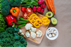 Fresh vegetables on a cutting board. Top view of Raw organic vegetables on a cutting board. Healthy Ingredients for vegetarian dish Royalty Free Stock Photo