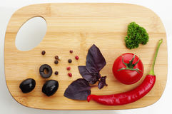 Fresh vegetables on cutting board. Stock Photos