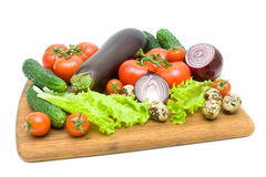 Fresh vegetables on a cutting board on a white background Stock Image
