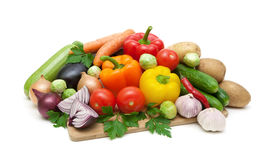 Fresh vegetables on cutting board on white background Royalty Free Stock Photos
