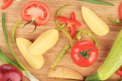 Fresh vegetables on cutting board. Royalty Free Stock Photo