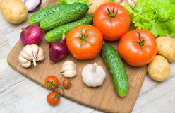 Fresh vegetables on a cutting board on a wooden table. Close up. horizontal photo Stock Images