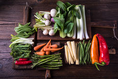 Fresh vegetables on cutting rustic boards Stock Photos