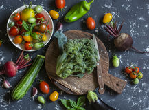 Fresh vegetables on dark background - broccoli, tomatoes, peppers, beets, eggplant, radish. Vegetarian table. Royalty Free Stock Images