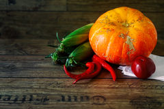 Fresh vegetables on a dark table. Autumn background. Healthy eating. Pumpkin, bell peppers, paprika, tomatoes, corn cob. Fresh vegetables on a dark table Royalty Free Stock Photo