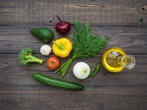 Fresh vegetables and decanter with sunflower oil on the table Stock Photo