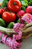 Fresh vegetables  diet with a measuring tape Stock Image