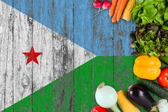 Fresh vegetables from Djibouti on table. Cooking concept on wooden flag background.  royalty free stock photography