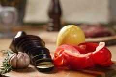 Fresh vegetables, eggplant, bell pepper, lemon, garlic and rosemary. Raw vegetables for grill Royalty Free Stock Image
