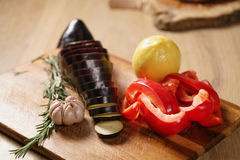 Fresh vegetables, eggplant, bell pepper, lemon, garlic and rosemary. Raw vegetables for grill Royalty Free Stock Photos
