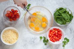 Fresh vegetables, eggs and cheese. Ingredients for healthy breakfast Stock Photos