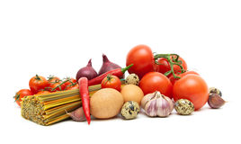 Fresh vegetables, eggs and spaghetti on a white background Royalty Free Stock Photography