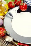 Fresh vegetables and empty plate (for your text) Stock Images