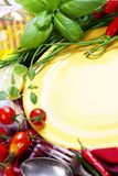Fresh vegetables and empty plate (for your text) Stock Image