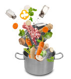 Fresh vegetables falling into stainless steel pot Stock Photography