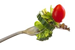 Fresh vegetables on a fork Royalty Free Stock Images