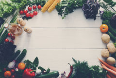 Fresh vegetables frame on white wood background with copy space Royalty Free Stock Images
