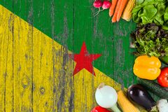 Fresh vegetables from French Guiana on table. Cooking concept on wooden flag background royalty free stock photography
