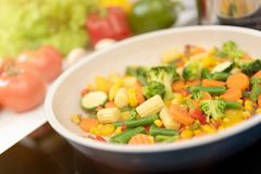 Fresh vegetables fried in a pan. Healthy nutrition concept. Healthy nutrition concept stock images
