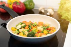 Fresh vegetables fried in a pan. Healthy nutrition concept. Healthy nutrition concept stock photography