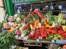 Fresh vegetables on a fruit stand in an outdoor store in London many different vegetables and fruits stock photography