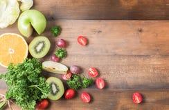 Fresh vegetables and fruit, tomato, parsley and kiwi fruit and o Royalty Free Stock Photo