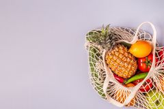 Fresh vegetables and fruits in bag mesh royalty free stock image