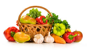 Fresh vegetables and fruits in a basket. Isolated on white Royalty Free Stock Photography