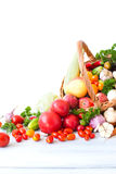 Fresh vegetables and fruits in a basket isolated on white background. Royalty Free Stock Images